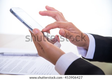 Close up of business woman using mobile smartphone - stock photo