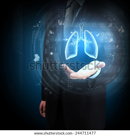 Close up of businessman and hologram of human lungs in his palm - stock photo