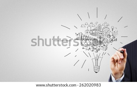 Close up of businessman hand drawing business strategy sketches - stock photo