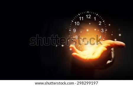 Close up of businessman hand holding clock  icon in palm - stock photo