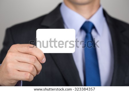Close up of businessman hand showing business card. Copyspace. - stock photo