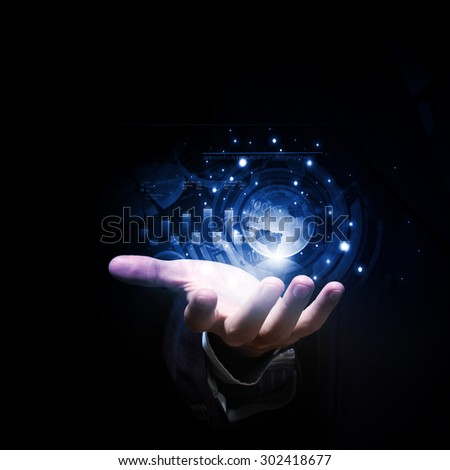 Close up of businessman hand showing digital planet - stock photo