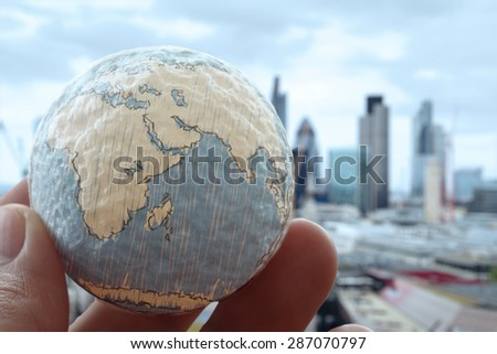 close up of businessman hand showing texture the world concept Elements of this image furnished by NASA london city background - stock photo