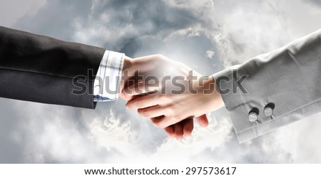 Close up of businessman hands making deal - stock photo