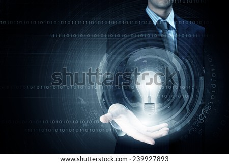 Close up of businessman holding bulb in palm - stock photo