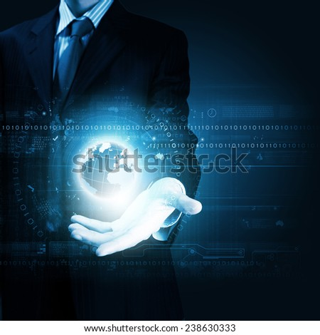 Close up of businessman holding digital globe in palm - stock photo