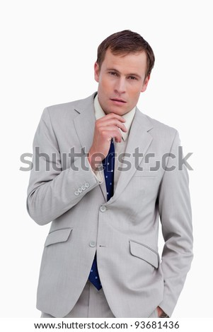 Close up of businessman in thoughts against a white background - stock photo