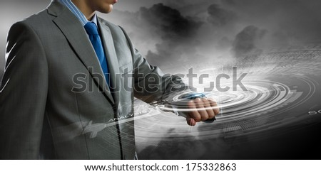 Close up of businessman looking at watch - stock photo