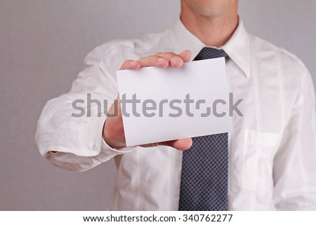 Close up of businessman showing blank card.  Business and finance. Copy space image. - stock photo