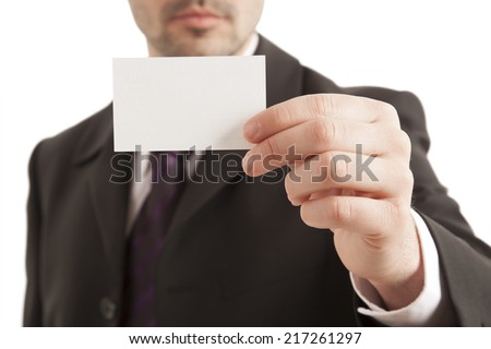 Close-up of businessman showing blank visiting card on white background - stock photo