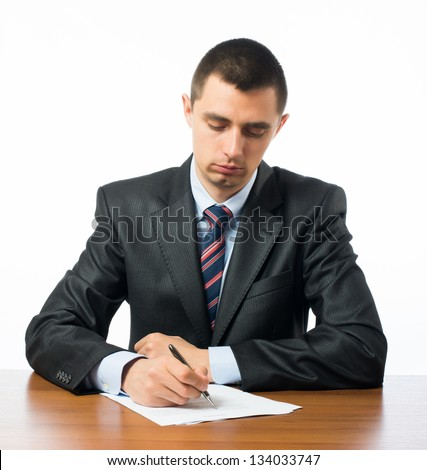 Close up of businessman signing a contrac - stock photo
