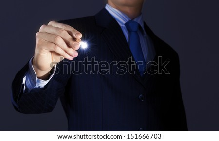Close up of businessman sketching business project - stock photo