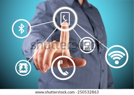 Close up of businessman touching application icon on screen - stock photo