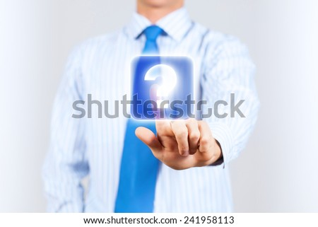 Close up of businessman touching icon in media screen - stock photo