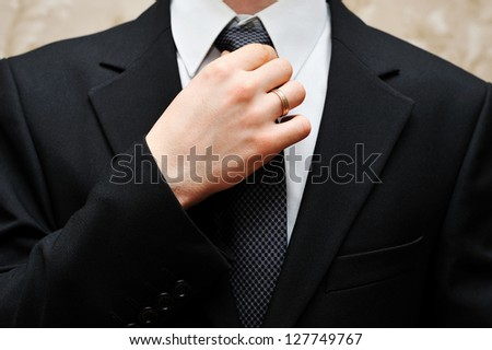 Close up of businessman wearing a tie, shirt, and suit. - stock photo