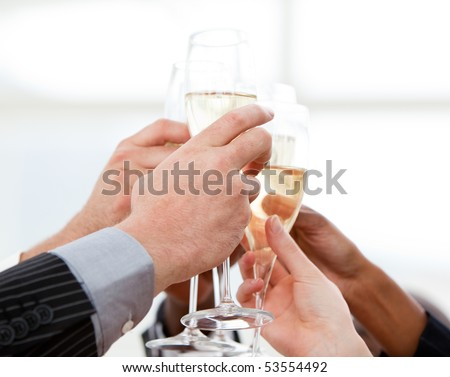 Close-up of businessmen celebrating an event with champagne in the company - stock photo