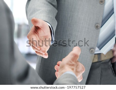 Close up of businessmen shaking hands - stock photo