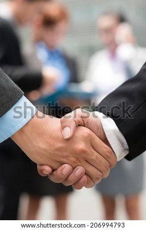 Close-up of businessmen shaking hands - stock photo