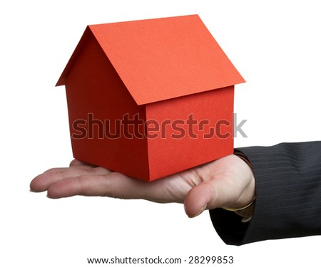close up of businesswoman and miniature house on white background with clipping path - stock photo
