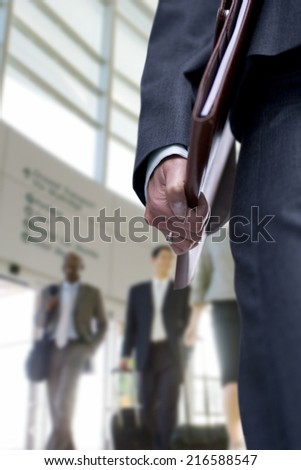 Close up of businesswoman carrying binder - stock photo