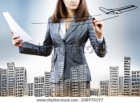 Close up of businesswoman drawing travel sketch - stock photo
