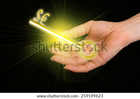 Close up of businesswoman holding golden key with the symbols of world currencies in hand - stock photo