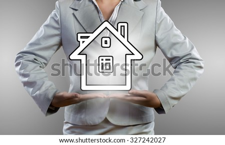 Close up of businesswoman holding in hands house model - stock photo