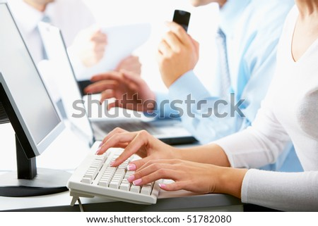 Close-up of busy businesspeople working in line - stock photo
