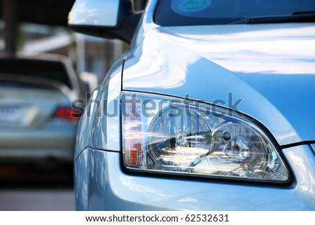 close-up of car head light. - stock photo