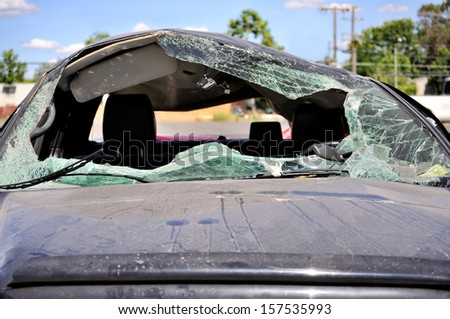 Close-up of car hood  and its broken windshield - stock photo