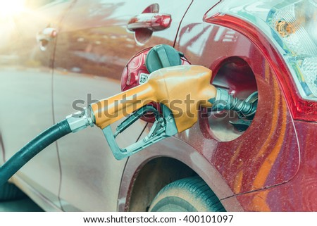 Close up of Car refueling on a petrol station. vintage effect - stock photo