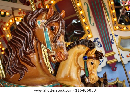 close up of carnival horses on a carousel - stock photo