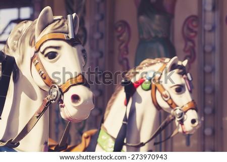 Close up of carousel horses. Vintage tone. - stock photo