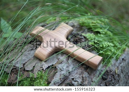 Close up of carved cross on trunk for a mourning background - stock photo