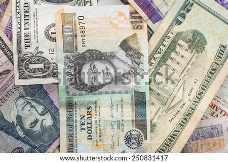 close up of cash bills from different countries around the world - stock photo