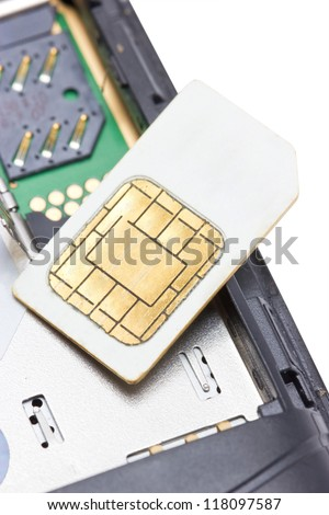 Close up of cell phone and sim card. - stock photo