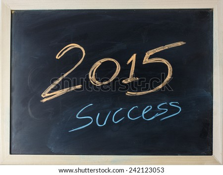close up of chalkboard with finance business 2015 and success topic - stock photo