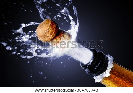 Close up of champagne cork popping - stock photo