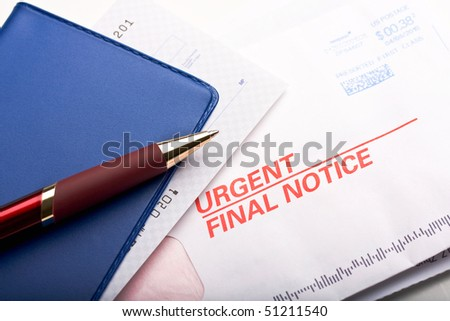 "Close up of check book over a business mail labeled ""Urgent final notice"". Concept of past due payment. - stock photo"