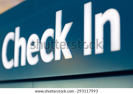 close up of check in sign at airport - stock photo