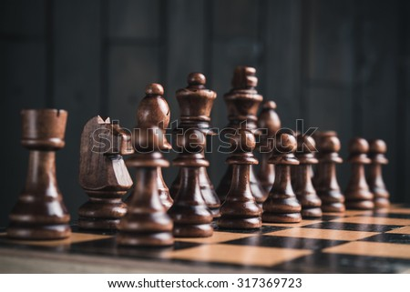 close up of chess pieces on chessboard - stock photo