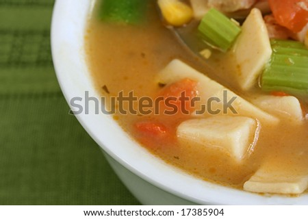 Close up of chicken and vegetable soup - stock photo
