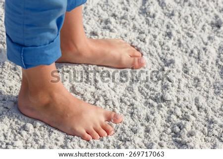 Close up of child feet on a tropical sandy beach, Florida, Siesta Key beach - stock photo