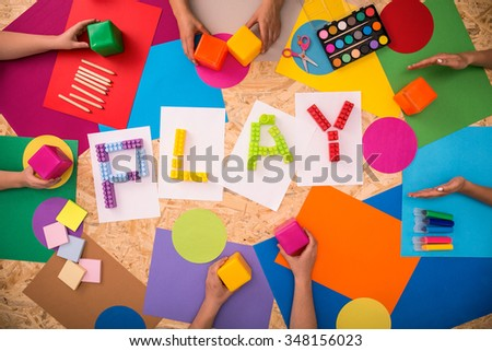 Close-up of children playing together in the kindergarten - stock photo