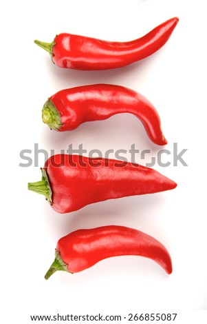 Close-up of chilli pepper on white background - stock photo