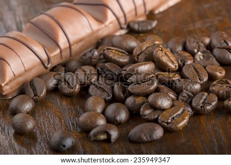 Close up of chocolate and coffee beans, shallow dof - stock photo