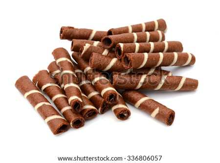 Close up of chocolate vanilla rolled wafer, selective focus. - stock photo
