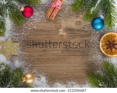 Close-up of christmas ornaments on wooden surface  - stock photo