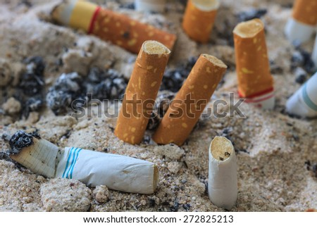 close up of Cigarettes butt in ashtray - stock photo