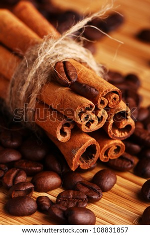 Close up of cinnamon sticks and coffee beans - stock photo